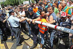 June 22, 2017 - Athens, Greece - Tension between Municipal waste collection workers and the police outside of the Greek parliament. The workers are fighting for their employment, as 10,000 temporary contracts are running out at the end of the month. (Credit Image: © Aristidis Vafeiadakis via ZUMA Wire)
