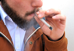File photo dated March 11, 2016 of a man with a beard smoking a joint. A French study found that only 4.4% of 350 coronavirus patients hospitalized were regular smokers and 5.3% of 130 homebound patients smoked. This pales in comparison with at least 25% of the French population that smokes. Researchers theorized nicotine could prevent the virus from infecting cells or that nicotine was preventing the immune system from overreacting to the virus. To test this theory, hospitalized coronavirus patients, intensive care patients and frontline workers nicotine patches. Photo by Tesson/ANDBZ/ABACAPRESS.COM
