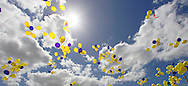 Yellow and purple balloons flying skywards <br /> Larger JPEGS and TIFFs available. Contact us via  www.photograhy4business.com