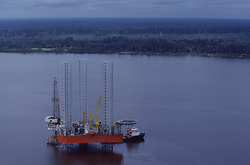 Stock photo of an offshore jack-up drilling rig in Sumatra.