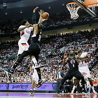 25 April 2016:  Portland Trail Blazers center Ed Davis (17) goes for the layup against Los Angeles Clippers forward Paul Pierce (34) as Los Angeles Clippers forward Jeff Green (8) vies for the rebound with Portland Trail Blazers forward Al-Farouq Aminu (8) during the Portland Trail Blazers 98-84 victory over the Los Angeles Clippers, during Game Four of the Western Conference Quarterfinals of the NBA Playoffs at the Moda Center, Portland, Oregon, USA.