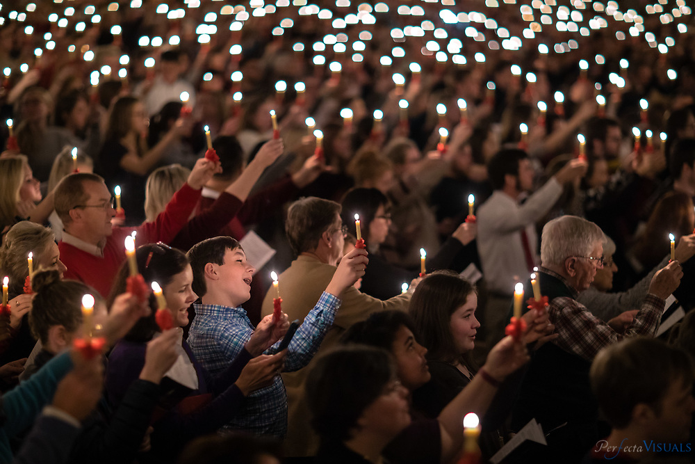 The annual Wake Forest Lovefeast at Wait Chapel.<br /> <br /> The crowd sings during the event.<br /> <br /> Photographed, Sunday, December 3, 2017, in Winston-Salem, N.C. JERRY WOLFORD and SCOTT MUTHERSBAUGH / Perfecta Visuals