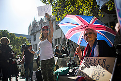 © Licensed to London News Pictures. 19/09/2019. London, UK. Pro Brexit supporters gather outside the The Supreme Court in London on day three of an appeal has been made against a judicial review of Boris Johnson's suspension of Parliament. The case has been brought by remain campaigner Gina Miller, with support from former British Prime Minister John Major. Photo credit: Ben Cawthra/LNP