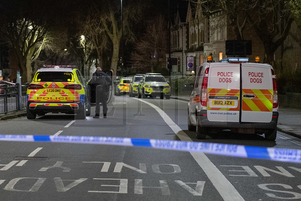© Licensed to London News Pictures. 07/04/2021. London, UK. Police vehicles and a dog unit on Chiswick High Road following a incident in which a vehicle was stopped at approximately 22:30hrs on Wednesday 07/04/2021 when police approached the vehicle, officers discovered the lone male occupant had sustained a number of serious self-inflicted injuries. First aid was commenced immediately and the London Ambulance Service were called. The male has been taken to a west London hospital. Photo credit: Peter Manning/LNP