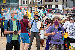 © Licensed to London News Pictures; 11/06/2021; St Ives, Cornwall UK. G7 summit in Cornwall. Extinction Rebellion protest on Porthminster Beach in St Ives on the first day of the G7 summit. Photo credit: Simon Chapman/LNP.