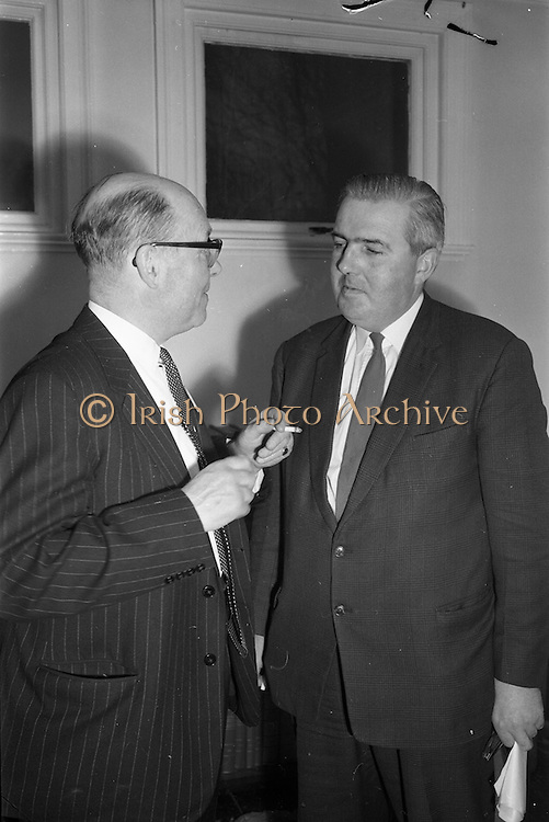 18/04/1963<br /> 04/18/1963<br /> 18 April 1963<br /> Closed circuit telephonic Pig Production meeting at the R.D.S., Dublin. Meetings on pig production were held simultaneously at the R.D.S. and Preston, Lancashire using closed circuit telephonic link. The meetings were sponsored by Smith, Kline and French Laboratories Ltd. and Goodbodys Ltd. Picture shows Mr. W.R. Goodbody, Managing Director Goodbody Ltd. and Mr. W.R. Day, Department of Agriculture, who pressided at the meeting.