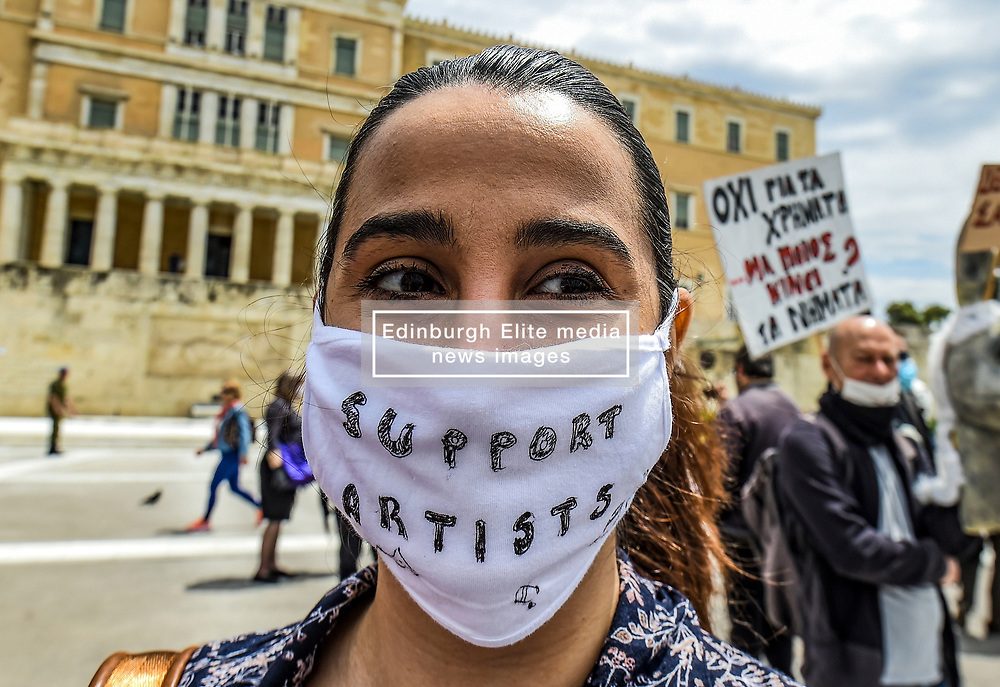 """A woman wears a protective facemask reading the message """"support artists"""" as she takes part in a demonstration, in Syntagma Square in front of the Greek parliament in central Athens, on May 7, 2020 during a rally organised by artists, musicians and actors to ask for help to the Greek government for the financial loses due to the lockdown aimed at curbing the spread of the COVID-19<br /> <br /> Pictured: <br /> Dimitris Lampropoulos  