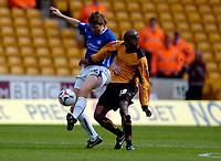 Photo: Richard Lane.<br /> Wolves v Leicester City. Coca Cola Championship.<br /> 17/09/2005.<br /> Leicester's Joey Gudjonssen is challenged by George Ndah.