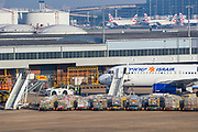 Two Israeli airline planes are seen parking and unloading at Heathrow Cargo centre near runway 27L on Thursday, April 16, 2020. <br /> With passenger travel set to fall 90% in April, the UK air hub is prioritising cargo, especially medical supplies. The number of cargo-only flights at Heathrow has surged to five times normal levels, with the airport now saying it is prioritising medical supplies as passenger travel grinds to a halt. (Photo/Vudi Xhymshiti)