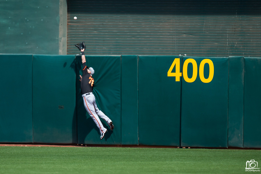 San Francisco Giants center fielder Steven Duggar (78) makes a catch at the wall against the Oakland Athletics at Oakland Coliseum in Oakland, California, on March 25, 2018. (Stan Olszewski/Special to S.F. Examiner)