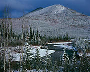 Lake Creek meandering through landscape coated with the coming winter's first snow, Shakwak Ranges, Yukon Territory, Canada.