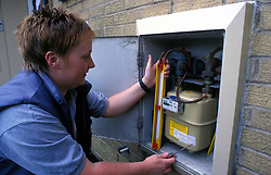 Female gas fitter at work