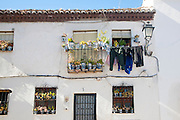 Historic whitewashed house detail Albaicin district, Granada, Spain with washing drying on the balcony