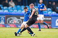 Macclesfield Town midfielder Connor Kirby challenged by Mansfield Town goalkeeper Conrad Logan during the EFL Sky Bet League 2 match between Macclesfield Town and Mansfield Town at Moss Rose, Macclesfield, United Kingdom on 16 November 2019.