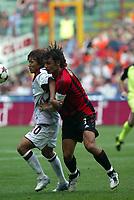 Fotball<br /> Itaoia 2004/05<br /> AC Milan v Reggina<br /> 3. oktober 2004<br /> Foto: Digitalsport<br /> NORWAY ONLY<br /> Maldini e Nakamura
