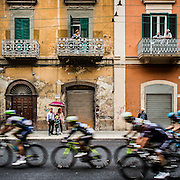Stage five and the first in Italy. The city of Bari was abuzz with excitement as the riders negotiate the wet streets. The faces of the riders were black with road grime. Stage 5, Bari, IT.<br /> Giro d'Italia, 2014