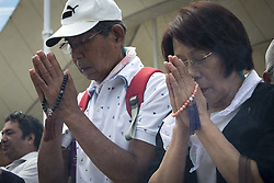 August 9, 2016 - Nagasaki, Nagasaki Prefecture, Japan - NAGASAKI, JAPAN - AUGUST 9 : Visitors pray for the atomic bomb victims in front of the Peace Statue in Nagasaki Peace Park, Nagasaki, southern Japan, Tuesday, August 9, 2016. Japan marked the 71st anniversary of the atomic bombing on Nagasaki. On August 9, 1945, during World War II, the United States dropped the second Atomic bomb on Nagasaki city, killing an estimated 40,000 people which ended World War II. (Credit Image: © Richard Atrero De Guzman/NurPhoto via ZUMA Press)