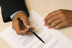 Student reading an exam paper during a secondary school examination,