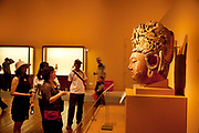 Ancient Chinese art on show in an exhibition at The National Museum of China flanks the eastern side of Tiananmen Square in Beijing, China. The mission of the museum is to educate about the arts and history of China. It is directed by the Ministry of Culture of the People's Republic of China. The museum was established in 2003 by the merging of the two separate museums that had occupied the same building since 1959. The building was completed in 1959 as one of the Ten Great Buildings celebrating the ten-year anniversary of the founding of the People's Republic of China. After four years of renovation, the museum reopened on March 2011 with 28 new exhibition halls, more than triple the previous exhibition space, and state of the art exhibition and storage facilities. It has a total floor space of nearly 200,000 square meters to display. The renovations were designed by the German firm Gerkan, Marg and Partners.