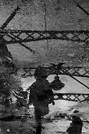 France. paris.  little boy playing in the water on arsenal bridge, canal de la Bastille  / petit garcon jouant sur la passerelle de l'arsenal, canal de la Bastille ,