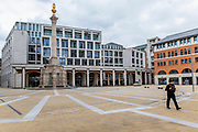 Paternoster square is virtually empty, apart from a solitary City of London Policeman on patrol - People get out to get their days exercise or shopping - most practice social distancing. The 'lockdown' continues for the Coronavirus (Covid 19) outbreak in London.