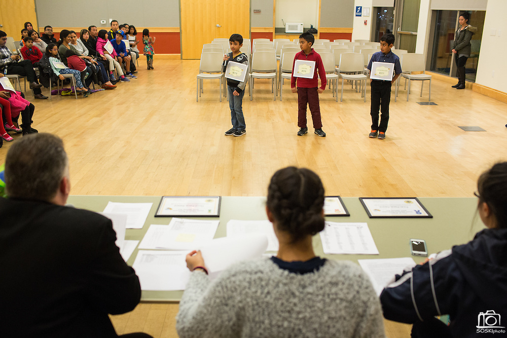 First through Third competitor Daksh Sharma spells out a word next to Krish Shah, center, and Jibril Asif Moinuddin, right, during the 2016 Milpitas Youth Spelling Bee at the Milpitas Senior Center in Milpitas, California, on January 22, 2016. Due to the enrollment in the first through third grade category, two separate Spelling Bees had to be held. (Stan Olszewski/SOSKIphoto)
