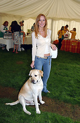MRS ANTHONY COOMBS and her dog at the Macmillan Cancer Relief Dog Day held at the Royal Hospital Chelsea South Grounds, London on 6th July 2004.