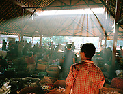Vendor in light with red shirt at Bug Bug market