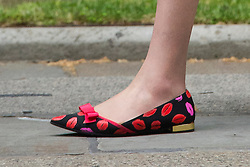 © Licensed to London News Pictures. 08/07/2015. London, UK. Home secretary THERESA MAY, wearing lipstick patterned shoes, as he arrivies at 10 Downing Street for a pre budget Cabinet meeting, before British Chancellor of the Exchequer, GEORGE OSBORNE annonces the first fully Conservative budget in 19 years.  Photo credit: Ben Cawthra/LNP