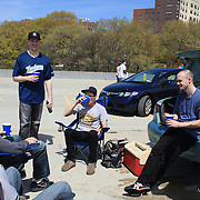 Yankee fans drink in a car park near Yankee stadium before the New York Yankees V Los Angeles Angels Baseball game at Yankee Stadium, The Bronx, New York. 15th March 2012. Photo Tim Clayton