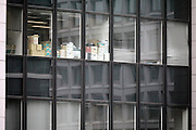 office high rise windows with boxes and paperwork, Tokyo