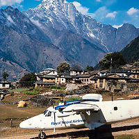 A Twin Otter STOL plane takes off at Lukla airstrip in the Khumbu region of Nepal 1986.