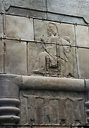 Plaster cast from Persepolis.  The image opposite is made from part of one side of a huge doorway to a palace built between 470-450 BC.  It shows the king sitting on a throne and holding a sceptre and lotus flower.  An attendant stands behind and above is a richly decorated canopy.