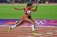 United States' Allyson Felix crosses the finish line in the Women's 200M final at the London 2012 Summer Olympics on August 8, 2012 in Stratford, London. Felix won the Gold Medal in a time of 21.88 seconds.  (UPI)