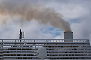 Diesel smoke pours from the funnels of Brittany Ferries roll-on / roll-off car ferry on 26th September 2021 in Roscoff, Brittany, France. Brittany Ferries is the trading name of the French shipping company, BAI Bretagne Angleterre Irlande S.A. founded in 1973 by Alexis Gourvennec, that operates a fleet of ferries and cruise ferries between France and the United Kingdom.