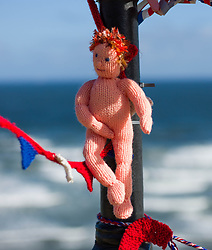 © Licensed to London News Pictures. 26/08/2012..Saltburn, England..Adding to the large collection of knitted figures that have appeared in Saltburn in Cleveland over recent months representing the Olympics and the Jubilee the mysterious knitters from the town show that they are not averse to a little scandal with their latest addition to the display near the cliff lift in the town...Photo credit : Ian Forsyth/LNP