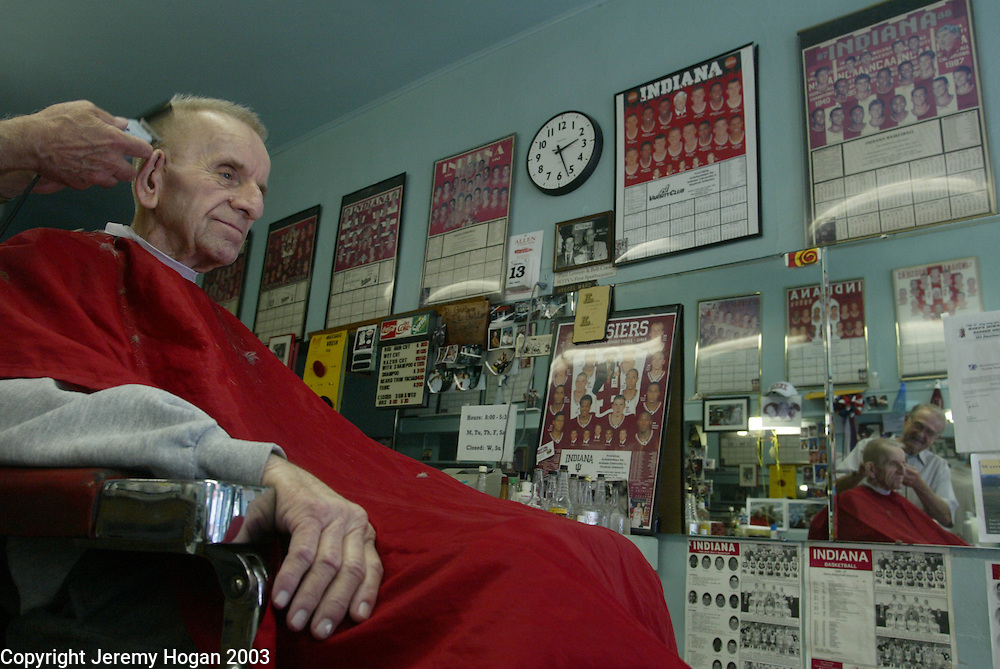 """Hyscel Ward, who has been a barber for 43 years, cuts O'Earl Toole's hair. Toole has been going to Ward for 38 years to get his haircut. Toole is a WWII veteran and was recently given six months to live. Toole was responsible for rescuing the lost squadron July 24th 1942. """"He loves what he gave his country,"""" said Ward. Ward's business has fallen off since he had heart surgery a few months ago and had closed his shop for a few weeks but loyal customers continue to come from miles around."""