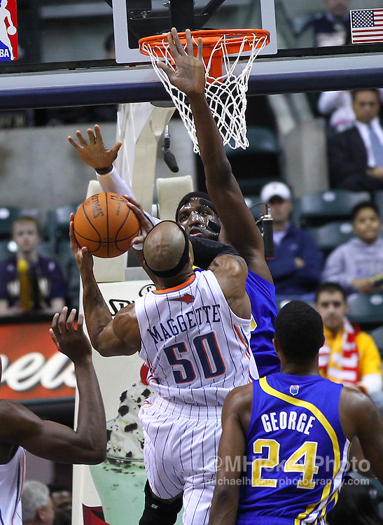 Feb. 19, 2012; Indianapolis, IN, USA; Charlotte Bobcats small forward Corey Maggette (50) shoots the ball against Indiana Pacers center Roy Hibbert (55) at Bankers Life Fieldhouse. Mandatory credit: Michael Hickey-US PRESSWIRE