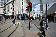 People out and about in the shopping district on Corporation Street in Birmingham, United Kingdom.
