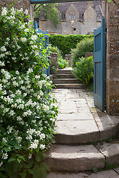 Steps and gate leading into Well Court at Snowshill Manor