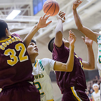 Newcomb Skyhawks Deondre Begay (22) and Nizhoni Johle (12) compete with Tohatchi Cougars Brennen Chee (34) and Byren Chee (32) for a rebound Saturday at Newcomb High School.