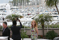 Chris Rock takes a photo and Jessica Chastain at the Madagascar 3: Europe's Most Wanted photocall at the 65th Cannes Film Festival. Friday 18th May 2012 in Cannes Film Festival, France.