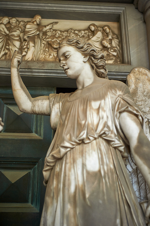 Picture and iamge of the stone sculpture of an angel with a grieving family on the steps of the Palrano tomb. Sculpted in a Borgeoise realistic style by C Rubatto in 1878. Section D no 09, the monumental tombs of the Staglieno Monumental Cemetery, Genoa, Italy .<br /> <br /> Visit our ITALY PHOTO COLLECTION for more   photos of Italy to download or buy as prints https://funkystock.photoshelter.com/gallery-collection/2b-Pictures-Images-of-Italy-Photos-of-Italian-Historic-Landmark-Sites/C0000qxA2zGFjd_k<br /> If you prefer to buy from our ALAMY PHOTO LIBRARY  Collection visit : https://www.alamy.com/portfolio/paul-williams-funkystock/camposanto-di-staglieno-cemetery-genoa.html