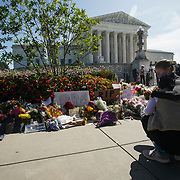 Mourners embrace as they pay their respects to the late Justice Ruth Bader Ginsburg at a makeshift memorial on outside the Supreme Court on Saturday, September 19, 2020.. Ginsburg passed away on Sept. 18 at the age of 87.