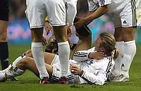 7/2/2004 Madrid, Spain.<br />La Liga (Spanish League) stage 23<br />R.Madrid 2 - Malaga 1<br />R.Madrid's D.Beckham after a strong knock at Santiago Bernabeu's Stadium.<br />© 2004 Alejandro leon Fernandez