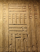 False door of Tjetji and his wife Debet. Limestone, Fourth or Fifth Dynasty, about 2500-2400 BC. From the tomb of Tjetji at Giza. This door comes from the same tomb. False doors were the main place for making offerings in the Old Kingdom. One of the dead person's spirits would pass through the door between the worlds of the dean and the living. The Central panel of this door shoes Tjeji and Debet receiving offerings, They appear on the side panels with their children.