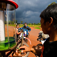 Gassing up a Baja 250 motorbike in Snuol, Cambodia