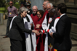 © Licensed to London News Pictures . 22/05/2018. Manchester, UK. THERESA MAY arrives at Manchester Cathedral for a Service of Remembrance on the first anniversary of the Manchester Arena bombing . On the evening of 22nd May 2017 The first anniversary of the Manchester Arena bombing . On the evening of 22nd May 2017 , Salman Abedi murdered 22 people and seriously injured dozens more , when he exploded a bomb in the foyer of the Manchester Arena as concert-goers were leaving an Ariana Grande gig . Photo credit: Joel Goodman/LNP