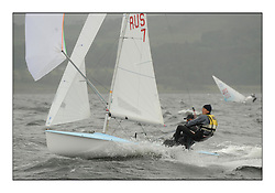 470 Class European Championships Largs - Day 2.Wet and Windy Racing in grey conditions on the Clyde..RUS7, Vladimir CHAUS, Denis GRIBANOV, Krasnodar Reg. .