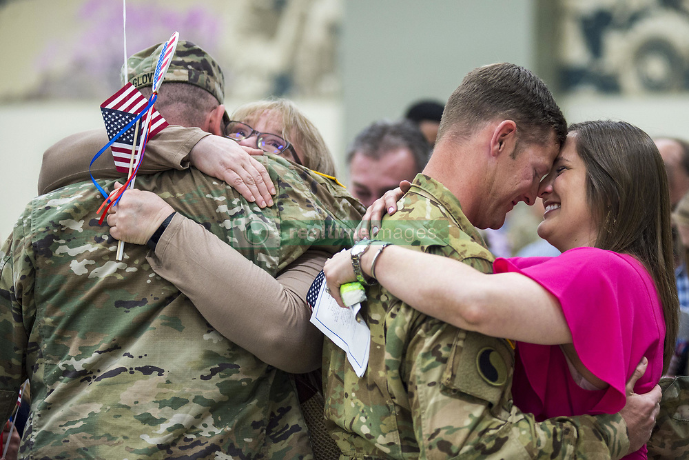 Apr 29, 2017 - Norman, Oklahoma, U.S. - Hugs at Home. Family members welcome Oklahoma Army National Guardsmen at the Armed Forces Reserve Center in Norman, Okla., April 29, 2017, as the soldiers return from a nearly yearlong deployment to the Middle East. Army National Guard photo by 1st Lt. Leanna Litsch. (Credit Image: ? Leanna Litsch/Army/DoD via ZUMA Wire/ZUMAPRESS.com)